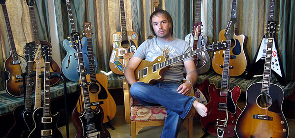 Austyn Brown with his guitar collection